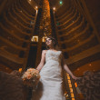 Happy bride in the modern hotel hall — ストック写真