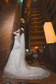 Happy bride in the modern hotel hall — Stock Photo