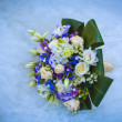 Stock Photo: Wedding bouquet on blue wedding dress