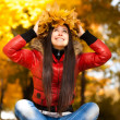 Pretty girl in a wreath of autumn leaves — Stock Photo