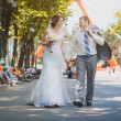 Bride and groom are sitting in the park — Stock Photo