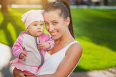 Mom and baby in the park — Stock Photo