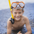 Happy boy  driver on the beach — Stock Photo