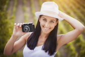 Happy girl photographer with retro camera — Stock Photo