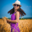 Portret of pretty woman on the yellow field — Stock Photo