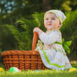 Cute baby in basket green park — Stock Photo #32517609