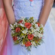 Beautiful bouquet in the the bride's hands — Stock Photo #32760895