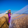 Girl with veil on the yellow field — Stock Photo