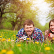 Stock Photo: Happy loving couple on spring meadow