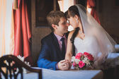 Bride and groom in the classic english interior — Stock Photo