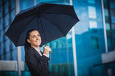 Businesswoman, on the modern building background — Stock Photo