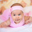 Funny baby girl in a pink dress — Stock Photo