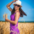 Woman on the yellow wheat field — Stock Photo