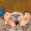 Children's feet on pebbles — Stock Photo