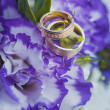 Stock Photo: Beautiful golden rings on blue wedding bouquet