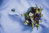 Wedding bouquet on the blue wedding dress — Stok fotoğraf