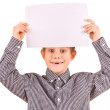 Funny cute boy with white sheet of paper — Stock Photo