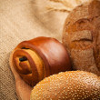 Assortment of baked bread on burlap background — Stock Photo