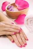 Manicure with fragrant rose petals and towel. Spa — Stock Photo