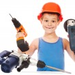 Little boy in a helmet with electric hammer — Stock Photo #36289485