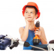 Little boy in a helmet with electric hammer — Stock Photo