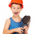Little boy in a helmet with electric hammer — Stock Photo #36421285