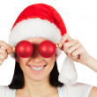 Girl in a Santa Claus hat with Christmas balls — Stock Photo
