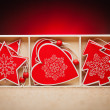 Set of Christmas decorations on a red background — Stock Photo