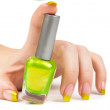 Woman's hand with a bottle of green nail polish — Stok fotoğraf