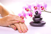 Beautiful manicure with pink orchid on the white — Stockfoto