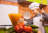 Boy chef is cooking in the kitchen — Stock Photo