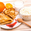 Morning breakfast. fresh pancakes, milk and cottage cheese — Stock Photo #41269169