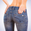 Stock Photo: Sexy wombuttocks in blue jeans on blue