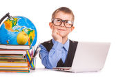 Schoolboy with books and laptop on a white — Stock Photo
