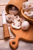 Fresh sliced champignon on the cutting board — Stock Photo