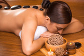 Beautiful brunette in a massage parlor — Stock Photo