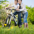 Boy on bike with mother — Stock Photo #42842773
