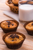 Freshly muffins with milk on the light  table — Stock Photo