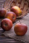 Red apples on wooden table, selective focus — Stock Photo