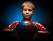 Cute boy is holding a football ball — Stock Photo