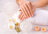 Beautiful hands with manicure and wnite orchid flower — Foto Stock