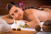 Beautiful brunette in a massage salon — Stock Photo