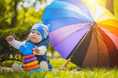 Cute baby are playing  in the green park — Stock Photo