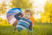 Portrait of a happy little boy in the park — Stock Photo