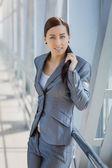 Cute businesswoman on the blue modern background — Stock Photo