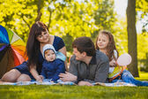 Happy family are plaing in the park — Stock Photo
