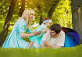 Happy young family spending time on a summer day — Stock Photo