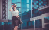 Business woman walking outside in city — Stock Photo