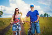 Man and woman riding bicycles — Stock Photo