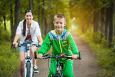 Mother and son riding bicycles — Stock Photo
